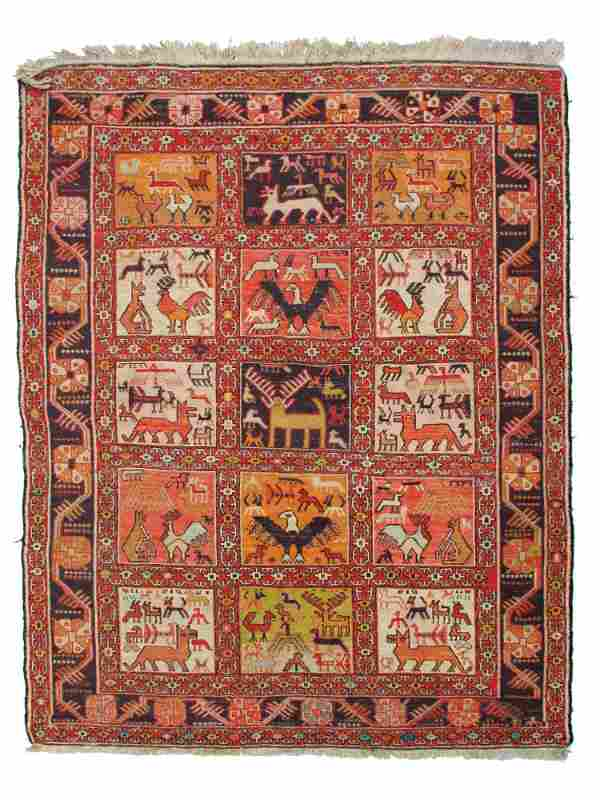 A VINTAGE PERSIAN HAND-KNOTTED SOUMAK RUG