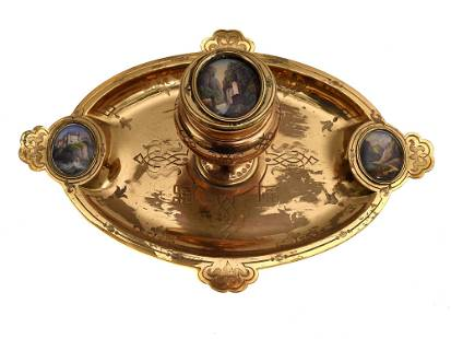 AN ANTIQUE BRONZE DESK ASHTRAY WITH INKWELL