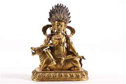 A top and fine gilt-bronze figure of buddha