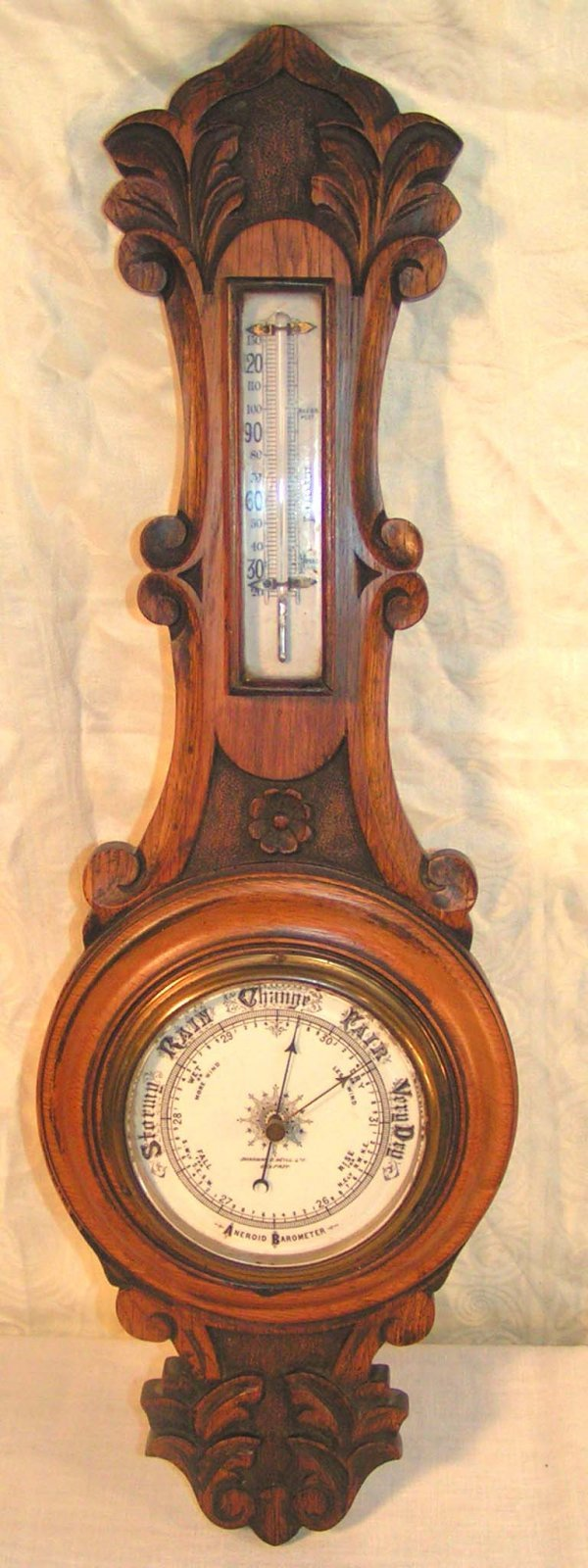 9: carved oak barometer marked sharman d neill ltd belf