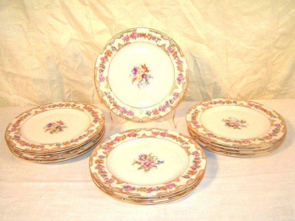 15: set of twelve royal bayreuth 8 inch plates gilt and