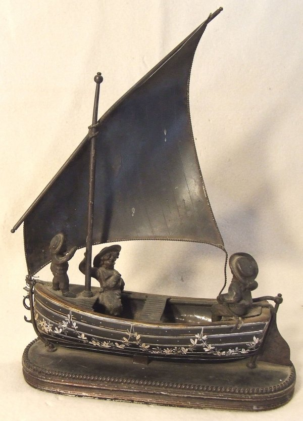 11: Bronze and white metal figural group in a sailboat