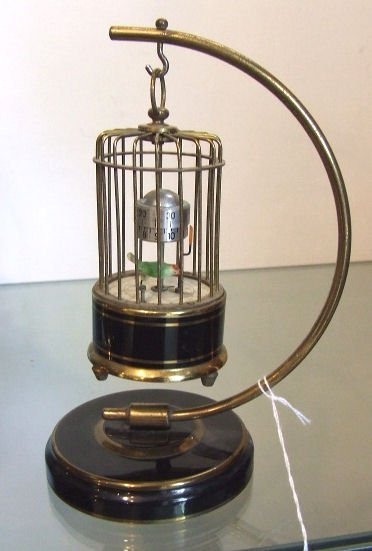 1070: J. Kaiser mechanical birdcage clock, Dunhill mark