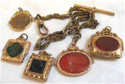 1038 5 Victorian pocket watch fobs and watch chain al