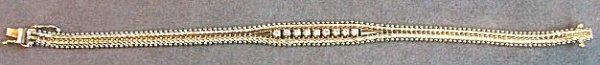 12: 14K gold & diamond bracelet.  Nine approx. 3pt. Dia