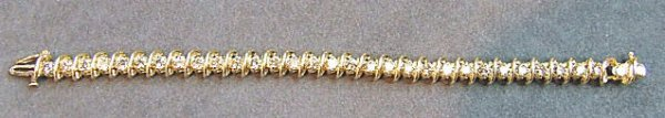 13: 14K gold & diamond tennis bracelet, set with 32 dia