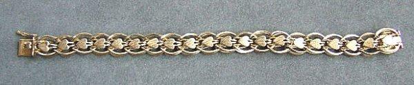 17: 14K yellow gold charm bracelet with heart decoratio