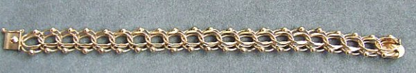 18: 14k yellow gold charm bracelet measuring 7.5 inches