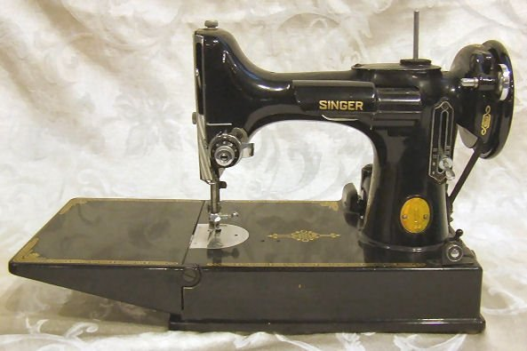 400: Singer Featherweight sewing machine.  Excellent co