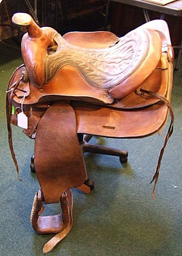 705: Estate Bufford western saddle #1153. Very good use