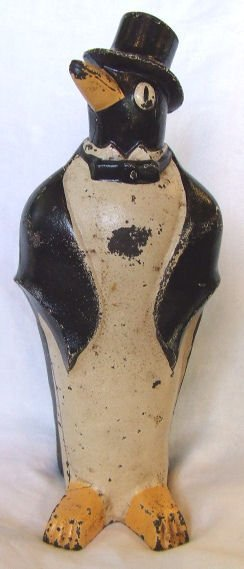 706: Penguin w. top hat cast iron  doorstop. Original p
