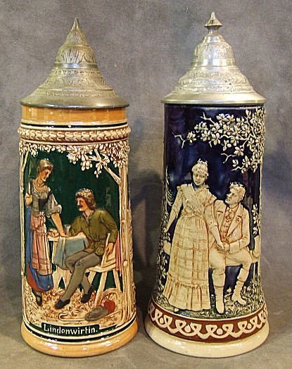 """8: 2 German relief pottery steins, .5L, 10.5"""" high. One"""