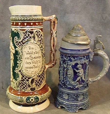 9: 2 German relief pottery steins, one with vine handle