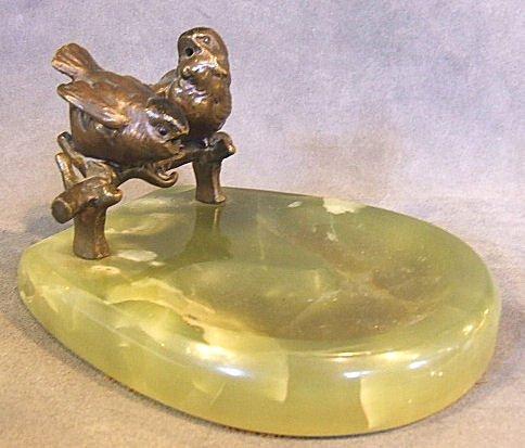 22: Bronze of 2 birds standing on twig, mounted on onyx