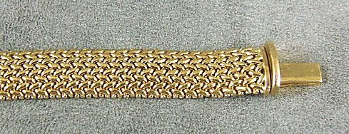135: Tiffany & Co. 18K yellow gold bracelet measuring 7