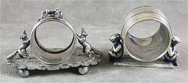167: 2 Victorian figural napkin rings, silverplate. One