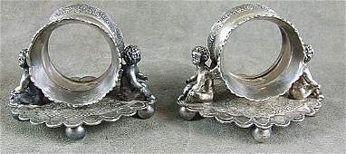 168: Pr. Victorian figural napkin rings, with cupids, m