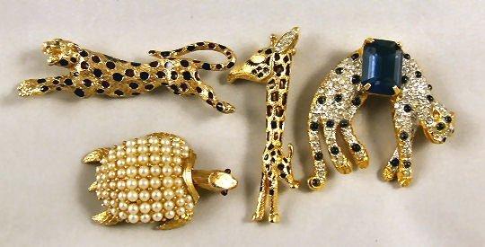 10: 4 pieces estate costume jewelry figural pins, Trifa