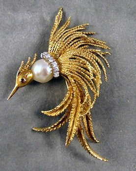 12: 18K yellow gold bird of paradise brooch set with 8