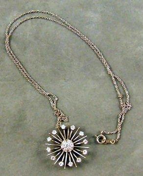 16: 18K white gold & diamond starburst pendant on light