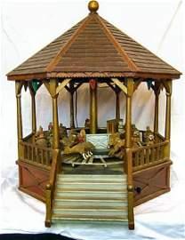203:  Large folk tramp art carousel with carved animal