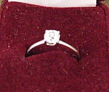 4: 14K white gold ring set with approx. 1/3 ct. diamond