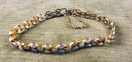"""12: 14k gold ladies bracelet with opal stones, 7 1/8"""" l"""