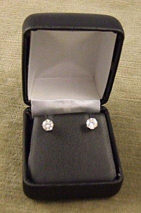 15: Pair of 14k white gold diamond earrings, total weig