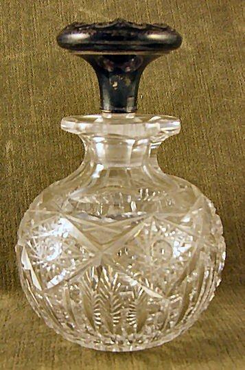 20: Large Victorian cut glass perfume w. ornate sterlin