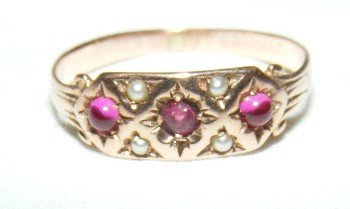 35: 14k gold Gypsy ring, 3 red stones with 4 seed pearl