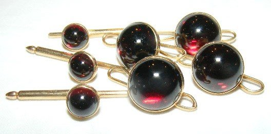 38: Tiffany & Co. 14k gold Tuxedo button set with red s