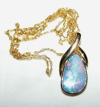 45: 14k gold necklace with fire opal pendant, both piec