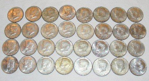 49: Silver clad Kennedy 1/2 dollars. (5) 1966, (17) 196