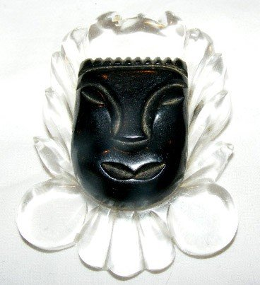"""52: Lucite and Bakelite mask pin. 2.75"""" x 2"""""""