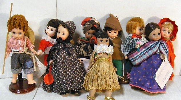 14: Lot of 9 Madame Alexander Miniature Showcase dolls,