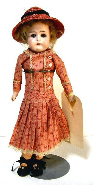 15: German bisque head doll with kid body, sleep eyes,