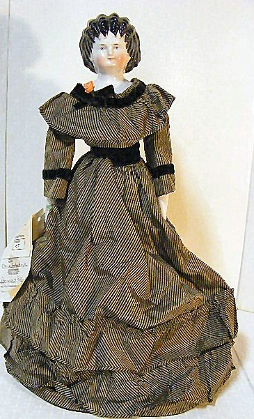 16: Unusual china shoulder head doll with spill curls,