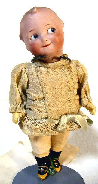 17: Scarce googly - eyed bisque head doll marked with m