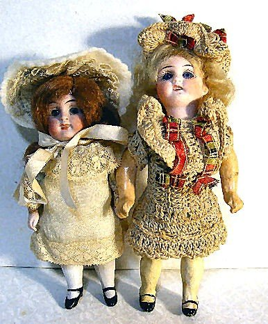 18: 2 small bisque head dolls with set glass eyes, one