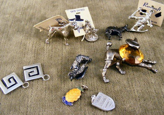 23: Lot of Trifari sterling poodle pin with topaz color