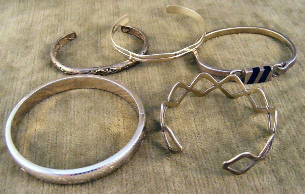 24: Lot of 5 sterling silver bracelets, on with Harley