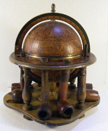 15: Italian globe humidor and pipe rack along with 8 pi