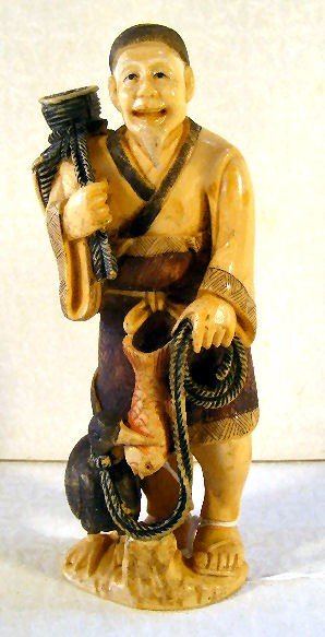 18: Ivory carving of fisherman with fish, basket and co
