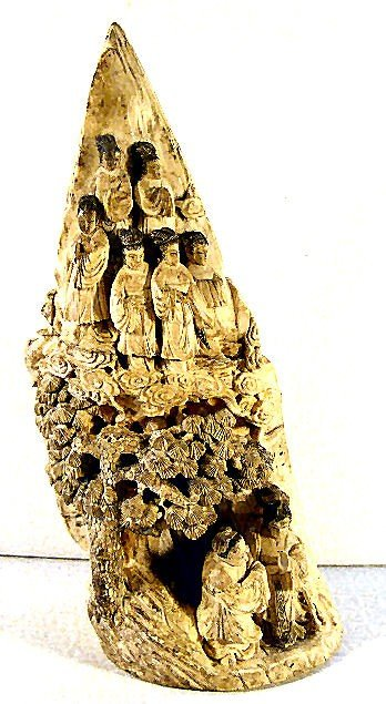 19: Carved oriental ivory tusk, 8 figures surrounded by