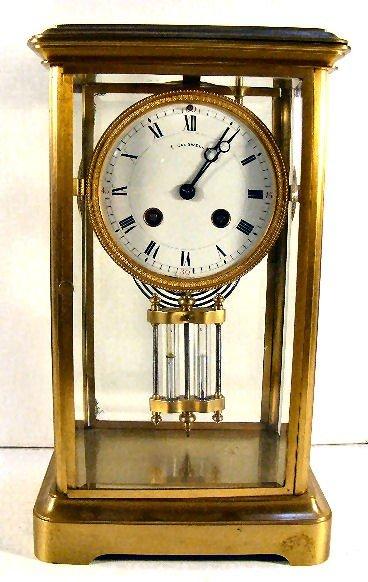 21: E. Caldwell & Co. clock, crystal regulator, beveled