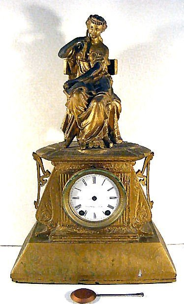 23: Seth Thomas mantle clock with classical themed spel