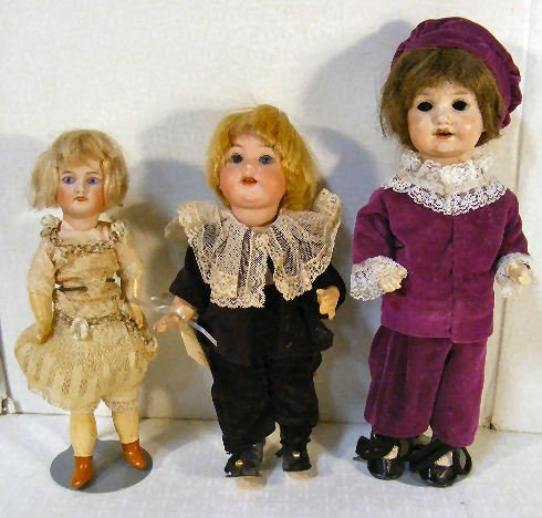 1A: Lot of 3 small bisque head dolls, Unis France child