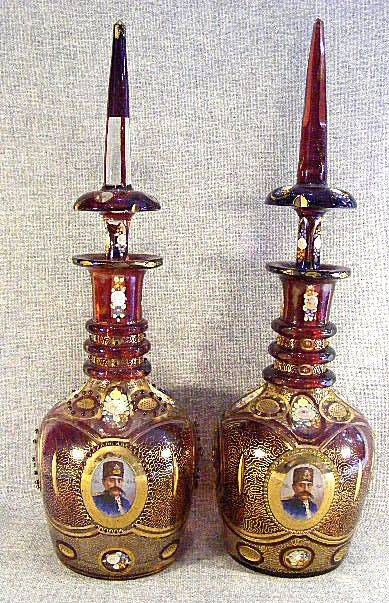 Pair of large Bohemian ruby flash decanters with P