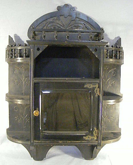 17P: Victorian Eastlake ebonized cabinet, beveled glass