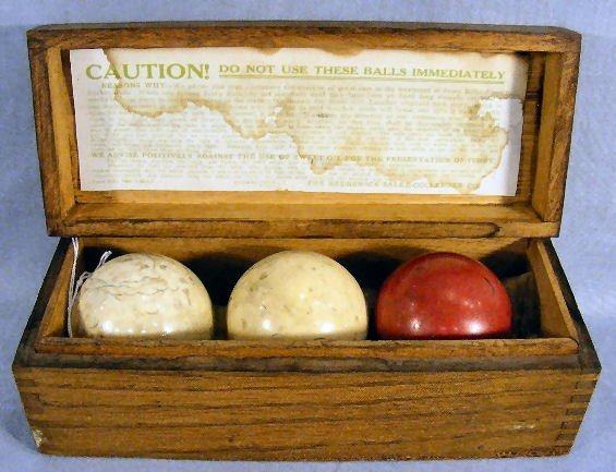 80T: Boxed Brunswick ivory billiard balls, surface spli